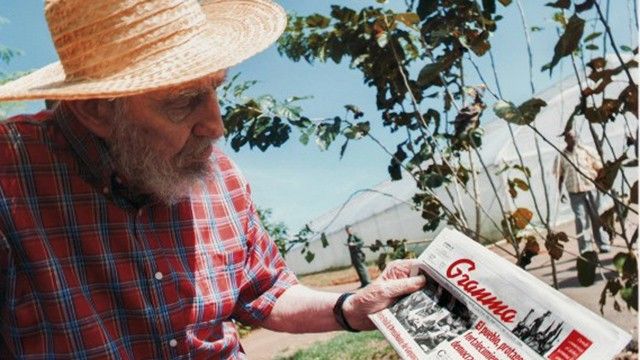 PHOTO:&nbsp;Fidel Castro holding a copy Friday's Oct. 19, 2012 edition of the newspaper Granma in Habana, Cuba.